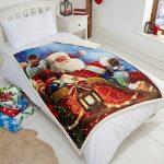 Tony's Textiles - Couverture en polaire douce - motif père Noël sur son traineau - 125 x 155cm de la marque Tony's Textiles image 1 produit